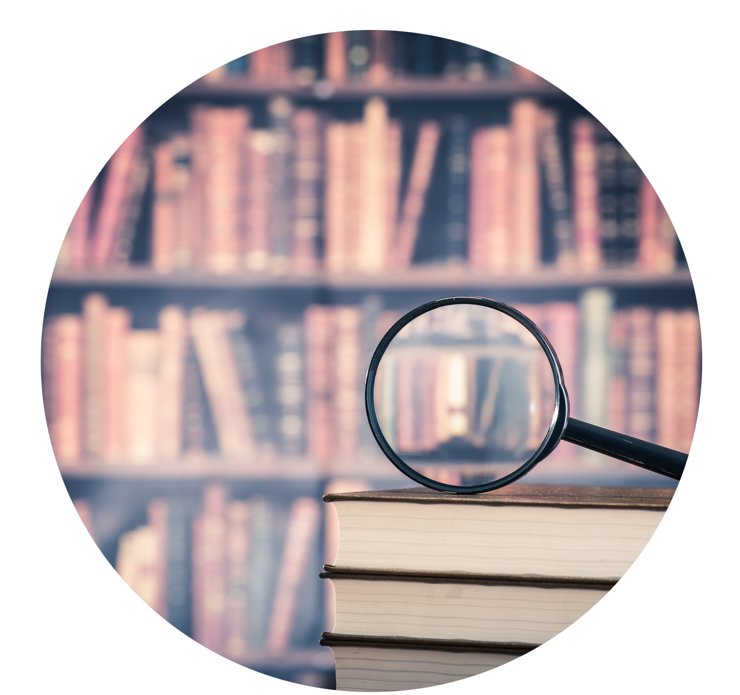 Magnifying glass over books