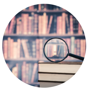 Magnifying glass focusing in on books