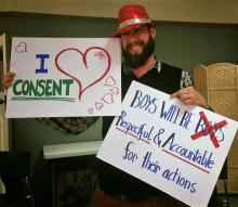 Some guy holding anti sexual assault signs