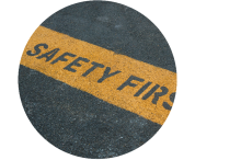'Safety First' written across bitumen